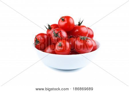 Red ripe tomatoes lying in a white plate on a white background. Isolated objects.