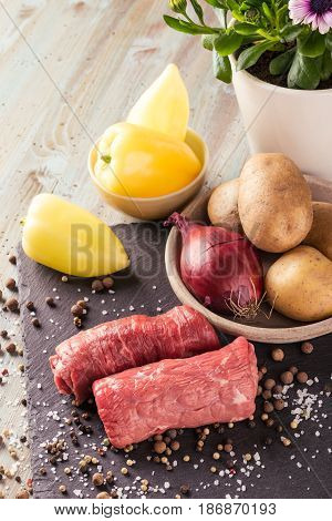 Photo Of Two Beef Rolls On Slate Stone With Spices
