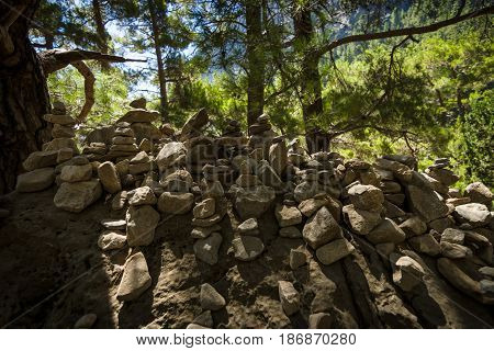 Samaria Gorge. Tourist tradition - a way of stones in the form of slides in series or in the form of a pyramid. Island of Crete Greece.