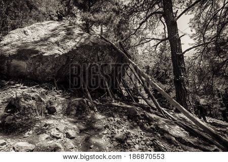 Samaria Gorge. Tourist tradition - to set the sham wooden stop under a large stone. Island of Crete Greece. Sepia. Stylization.