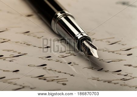 Letter pen writing utensil writing instrument close up fountain pen nib