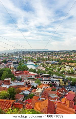 Panorama view of Tbilisi capital of Georgia country. Public Service Hall perestrian Bridge of Peace over Kura river. Cable road over the city.