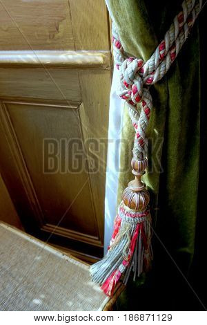 Lovely Delicate Curtain Tie Back On A Sage Green Curtain In Natural Window Light