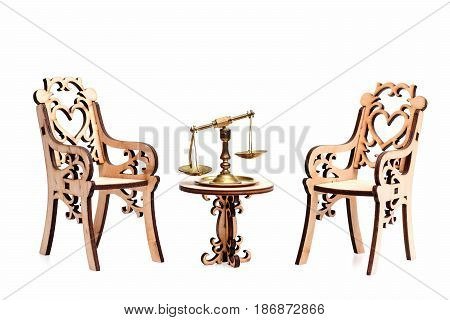 Golden Or Middling Scales On Table With Decorative Wooden Chairs