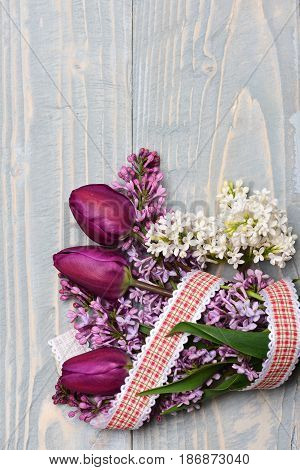 Date Concept. Bouquet Of Lilac Flowers With Tulips On Blue