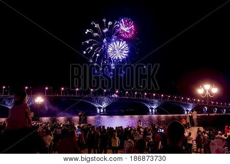 Fireworks on the bridge over the Volga river in Saratov, Russia