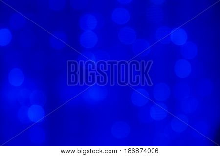 Abstract blurred blue background. The lights of illuminations or lights in a blur. Bokeh and defocusing