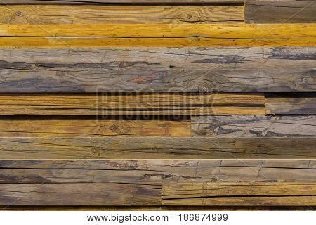 Close-up brown vintage natural wooden unpainted planks. Dark aged empty rustik pattern texture. For natural design, patterns, decoration