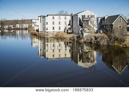 Houses on the Saco River. The river adjoining the two towns of Biddeford and Saco in Maine USA