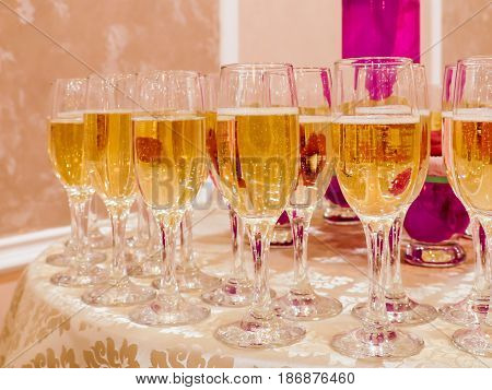Champagne in glasses on the Banquet tables.