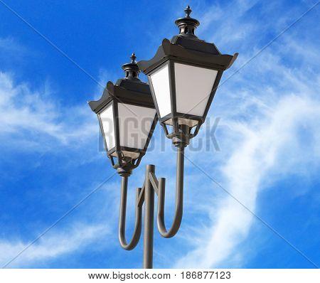 the street lantern on background blue sky