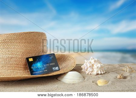 Travel concept. Credit card with hat on landscape background