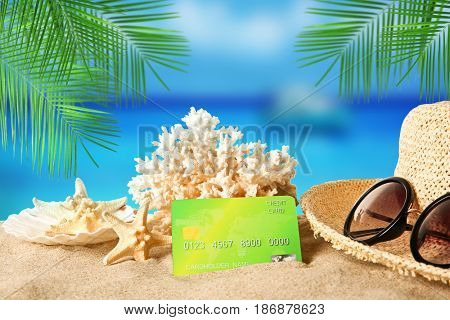 Travel concept. Credit card with coral on landscape background
