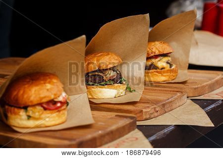 Delicious Burgers On Craft Paper, Serving Bbq At Open Grill, Outdoor Kitchen. Food Festival In City.