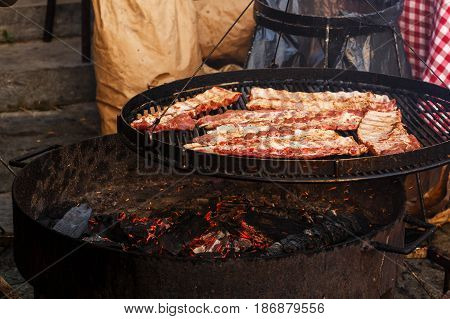 Delicious Meat Ribs Grilling On Open Grill, Outdoor Kitchen. Food Festival In City. Tasty Food Roast