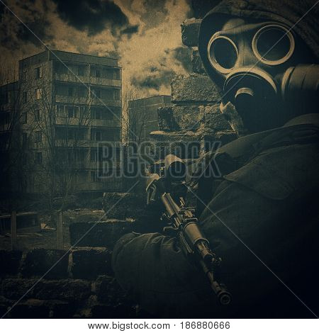 Old photo of man in gas mask with gun in hand