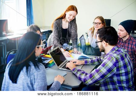 Group of students working on computers at university