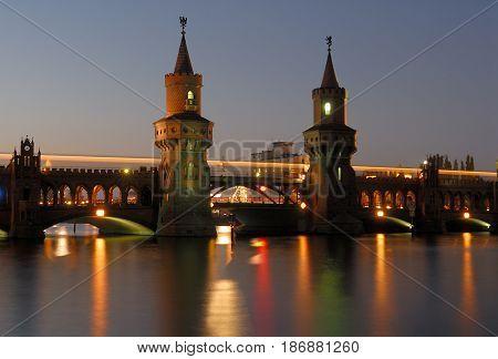 illuminatet oberbaumbruecke in berlin over river spree