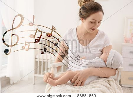 Mother with baby at home. Lullaby songs and music concept