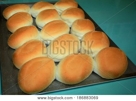 Pandesal freshly baked from the oven Pandesal or bread of salt is a popular bread bun in the Philippines usually dipped in hot coffee or stuffed with corned beef, fried egg or other fillings.