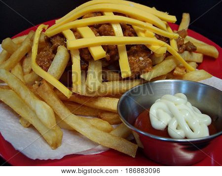 SANYO DIGITAL CAMERAMeatballs and french fries with mayo dip A serving of french fries topped with meatballs and strips of cheese served with ketchup and mayonnaise dip.