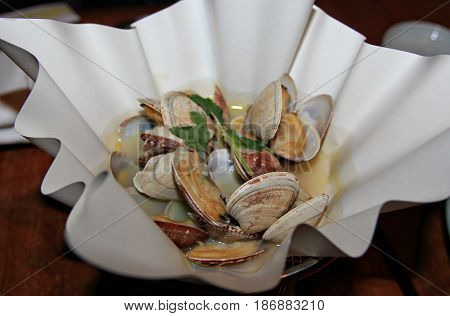 Clam soup served in a stylish bowl, top view Clam soup is a favorite of many and a specialty in many restaurants.