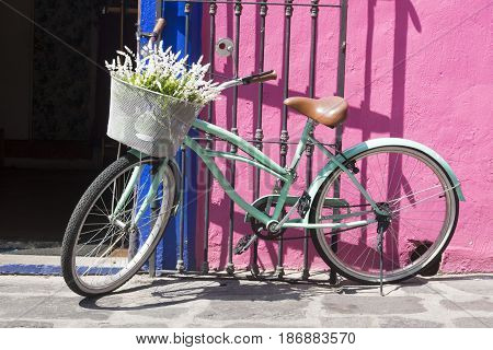 vintage bike in old color town, with flowers