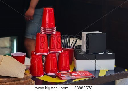 Empty Red Cups On Table For Beer Or Drinks At Market, Outdoor Kitchen. Food Festival In City.  Food-