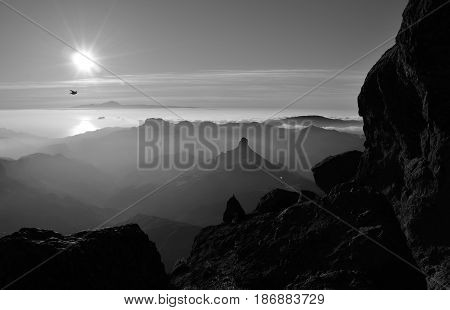 Silhouettes of mountains at sunset, summit of Gran canaria, Roque Bentayga and Tenerife island in the distance, Canary islands, monochrome mode