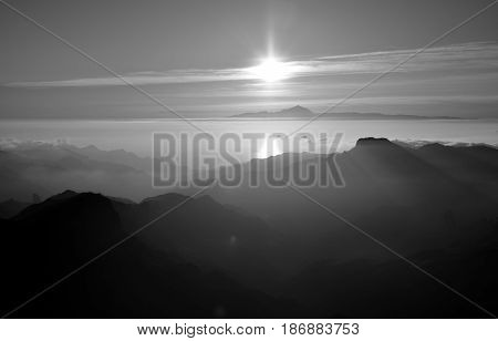 Sunset from the mountains, summit of Gran canaria and Tenerife island in the distance, Canary islands, monochrome mode