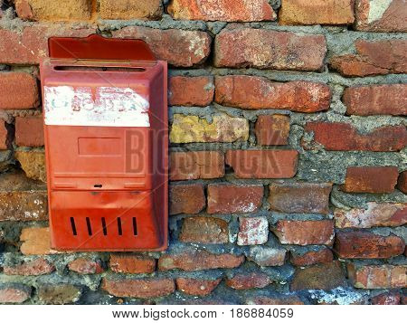 Old mailbox on a brick wall. Horizontal view.