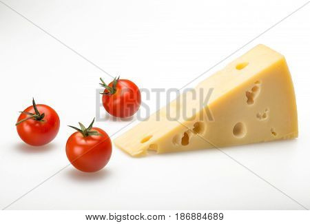 Cheese cheese piece cheese wedge emmental cheese swiss cheese slice cherry tomatoes