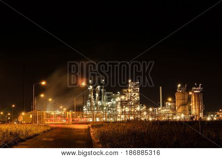 Petrochemical refinery at night behind a closed fence. Tessenderlo Flanders Belgium Europe