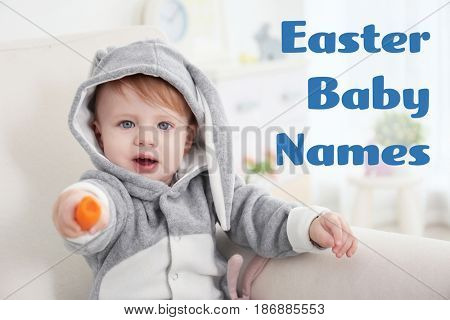 Concept of choosing Easter baby names. Little child in bunny costume with carrot sitting in armchair