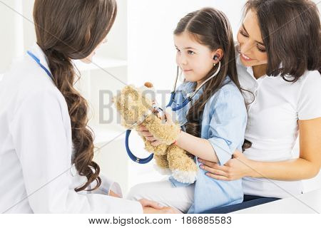 Mother and daughter at pediatrician office