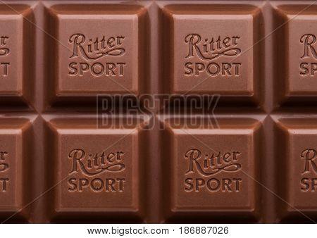 London, Uk - May 15, 2017:  Ritter Sport Milk Chocolate Bar Macro With Logo. Ritter Sport Chocolate