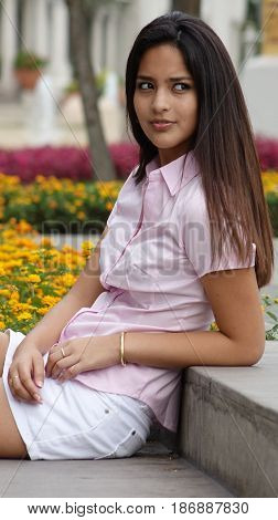 Latina Female Teen Sitting in Public Park