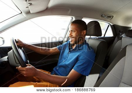 Happy Young African Man Driving A Car