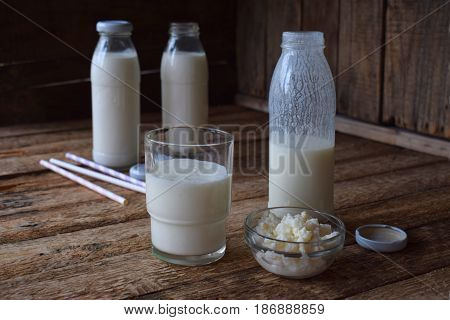 Sour-dairy Drink Or Yoghurt In Bottle That Come From The Kefir Grains And Milk On Wooden Background.