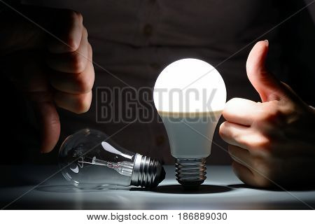 The Woman Shows A Like And Dislike Incandescent And Led Light Bulbs