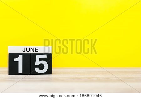 June 15th. Day 15 of month, calendar on yellow background. Summer day. Empty space for text. Global Wind Day. Tax DAY.