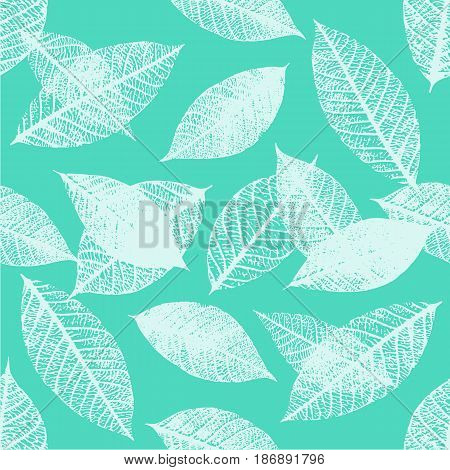 A seamless background pattern of skeleton leaves in teal blue, autumnal repeat print