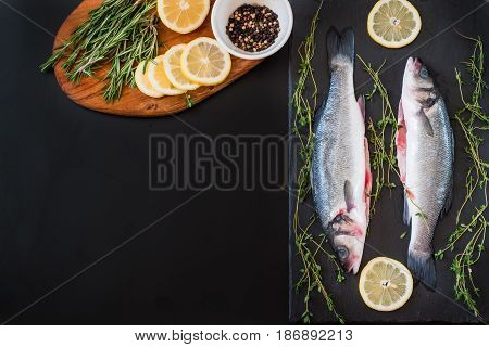 fresh seabass and spices on the table