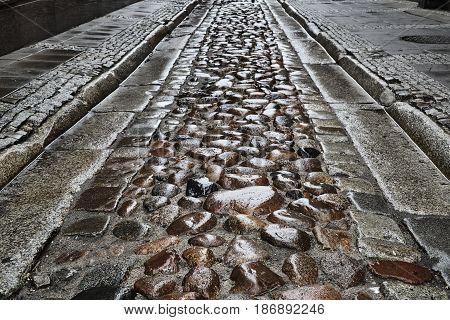 Granite cobblestones on a street in Poznan