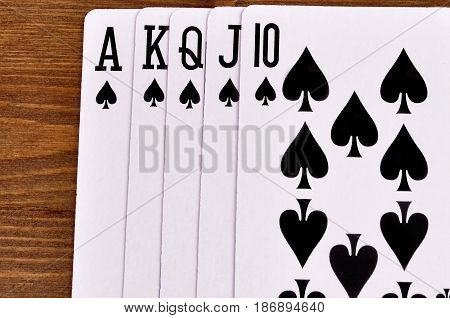 combination of royal flush of playing cards on a wooden background