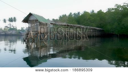 Bridge over the water, Puntalinao, Davao Oriental A crudely built bridge on stilts about the water serve as landing dock for boaters in Puntalinao fishing village, Davao Oriental, Philippines.