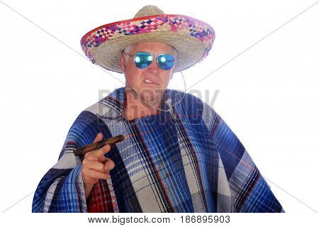 A man wears a Mexican Sombrero, a Serape or Poncho sunglasses and smokes a big cigar as he celebrate a Mexican holiday or tradition. Isolated on white, Room for text.