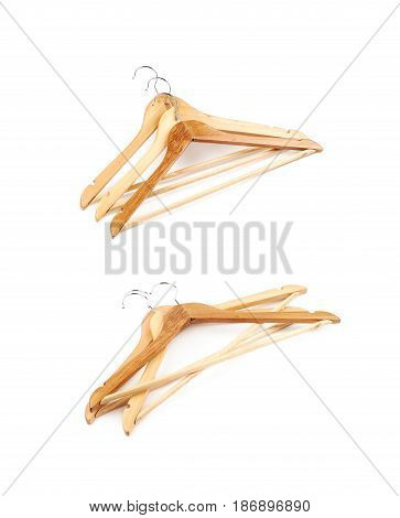 Pile of light wooden hangers isolated over the white background, set of two different foreshortenings