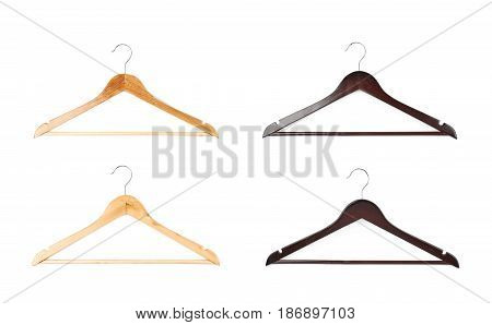 Dark and light wooden hangers isolated over the white background, each in two foreshortenings