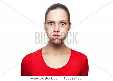 Portrait of bored unhappy woman in red t-shirt with freckles. looking at camera studio shot. isolated on white background.